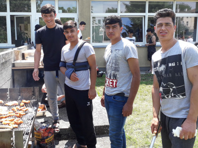 Unaccompanied minor refugees during barbecue in ÖJAB-Haus Mödling.
