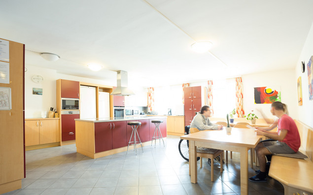 Comunal kitchen of a intergenerational living flat with residents.