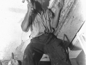 Young worker around 1946 working on a building