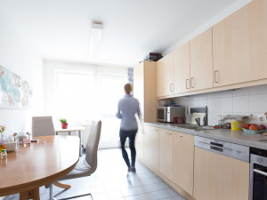 Kitchen of a intergenerational living flat with resident.