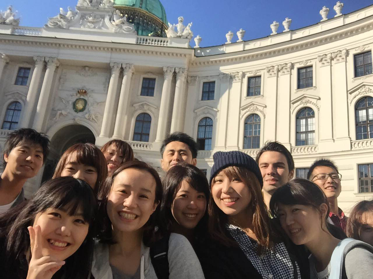 Japanese youth in Vienna, in the background is a part of the Vienna Hofburg visible.